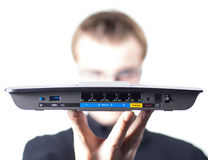 Man with wireless Router in hand Stock Photo