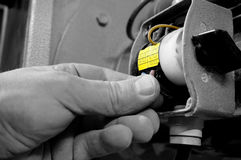 Man wiring an industrial switch. Royalty Free Stock Photography