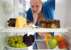 Man wish hard food rather than healthy food Royalty Free Stock Photo