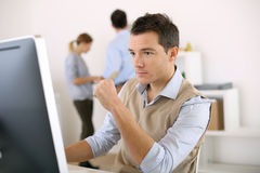 Man With A Serious Look Working In Office Royalty Free Stock Images