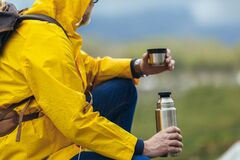 Free Man With Backpack Taking Break Of Hiking In A Beautiful Nature And Taking Tea Or Water From A Thermos Flask Royalty Free Stock Images - 181558979