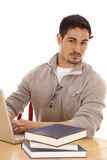 Man With Books And Laptop Stock Image