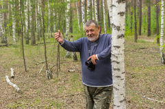 Man With Camera Standing Near Birch Royalty Free Stock Image