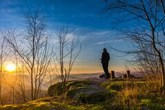 Free Man With Camera Standing On The Top Of A Mountain Watching The Sunrise Stock Photos - 183957743