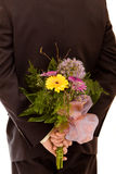 Man With Flowers Stock Photo