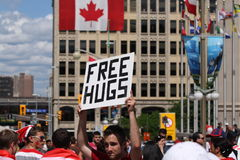 Man With Free Hugs Sign In Public Royalty Free Stock Photography
