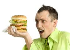 Man With Hamburger Royalty Free Stock Photos