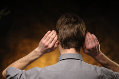 Man With Hands On Ears Royalty Free Stock Images