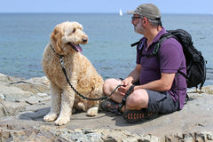 Free Man With His Dog Royalty Free Stock Image - 56366496