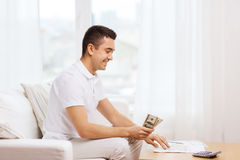 Man With Papers And Calculator At Home Royalty Free Stock Image