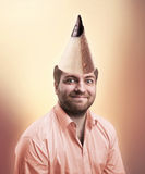 Man With Pencil Cone On The Head Royalty Free Stock Image