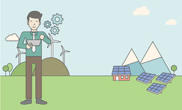 Man With Solar Panels And Wind Turbines Stock Images