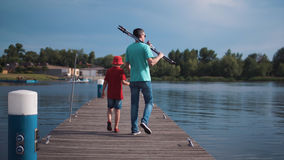 Free Man With Son Walking On Pier Stock Photos - 94384183