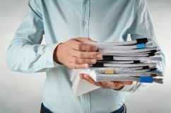 Free Man With Stack Of Documents Stock Photography - 107685432