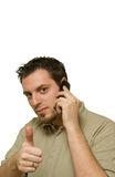 Man With Thumb Up On The Phone Stock Photo
