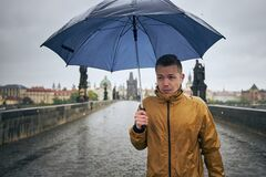 Free Man With Umbrella In Heavy Rain Royalty Free Stock Images - 182610009