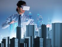 Free Man With Virtual Reality Goggles Doing Urban Planning Royalty Free Stock Photos - 182298998