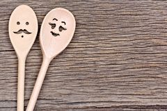Free Man With Woman Shape Of Wooden Spoons On Table Royalty Free Stock Photography - 106220657