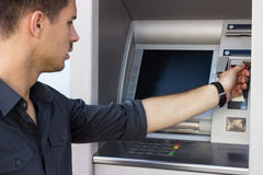 Man withdrawing money from an ATM Royalty Free Stock Images