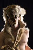 Man in wolf skin. Close up Stock Photos