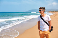 Man wolking on the beach Stock Photography