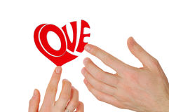 Man and woman. Hands composing word Love Royalty Free Stock Photos