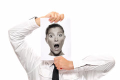 Man or Woman ?. Businessman holding a piece of paper over his face with a shocked woman on it Royalty Free Stock Photography