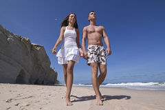 Man and woman. Man and womam in the beach relaxing Stock Photography