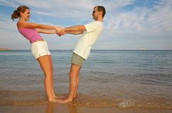 Man and woman. Stand on a beach stock photos