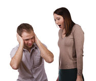 The man and the woman. Man shutting his ears and not listening to the persistent yelling of his spouse Stock Image
