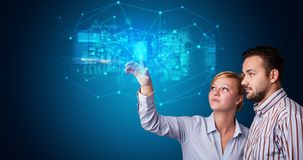 Man and woman accessing hologram with fingerprint. Man and woman accessing modern hologram personal database with fingerprint identification stock image