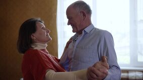 Man and woman of admirable age who have kept their love and affection for each other are happy to dance celebrating