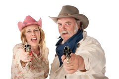 Man and woman aiming guns Royalty Free Stock Image