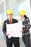 Man and Woman Architects on Construction Site Stock Image