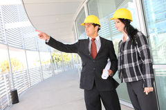 Man and Woman Architects on Construction Site Stock Photography