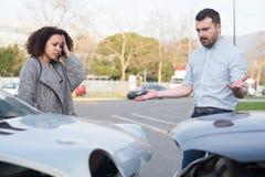 Man and woman arguing after bad car crash Royalty Free Stock Photos