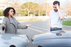 Man and woman arguing after bad car crash Stock Photo