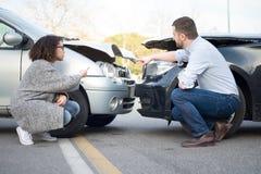 Man and woman arguing after a car crash Stock Photos