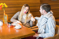 Man and woman arguing indoors stock images