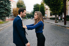 Man and woman arguing. Man and women arguing on a city street royalty free stock images