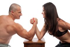 Man and woman arm wrestling. Strong man and woman doing arm wrestling isolated on white Stock Photography