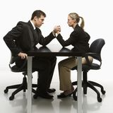 Man and woman arm wrestling Stock Images
