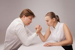 Man and woman in arm wrestling gesture Royalty Free Stock Photography