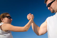 Man and Woman Arm Wrestling Outdoors Royalty Free Stock Images