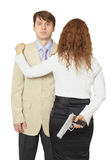 Man and woman armed by pistol Stock Photo