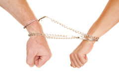 Man and woman arms handcuffs fists down Stock Photo