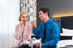 Man and woman arriving in hotel room Stock Image