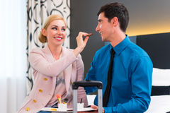 Man and woman arriving in hotel room Royalty Free Stock Photo