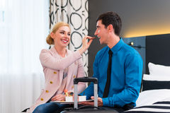 Man and woman arriving in hotel room Stock Photo