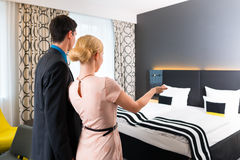 Man and woman arriving  in hotel Stock Photography